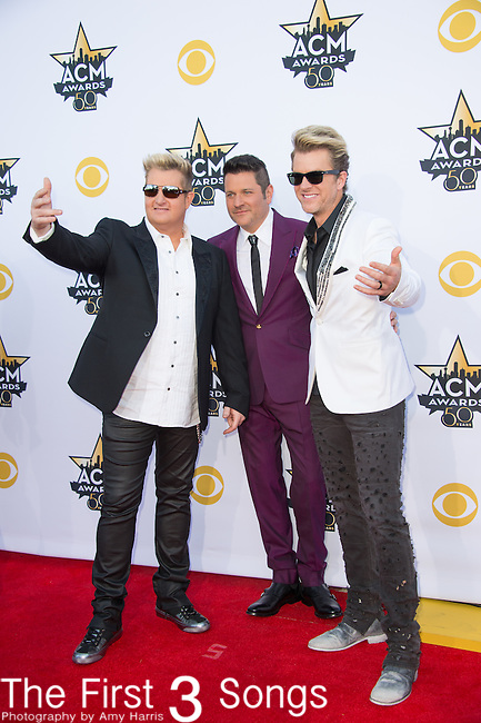 Gary LeVox, Jay DeMarcus, and Joe Don Rooney of Rascal Flatts attend the 50th Academy Of Country Music Awards at AT&T Stadium on April 19, 2015 in Arlington, Texas.