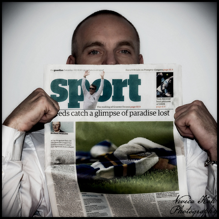 Mark looking over the top of The Guardian newspaper Sport page.