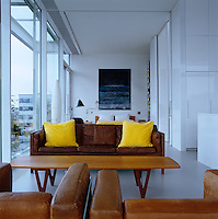 The master bedroom forms part of the open-plan living area on the upper level and can be sectioned off by sliding walls