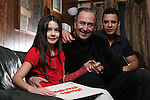 ".Tony ""Ham"" Guerrero and his son Alredo Guerrero of the Tortilla Factory jazz group is nominated for a grammy this year despite Tony's need for a kidney transplant. Photographed with Mikayla Guerrero (check spelling) at his home in Austin, Texas on February 2, 2009 ..Photo by Ben Sklar"