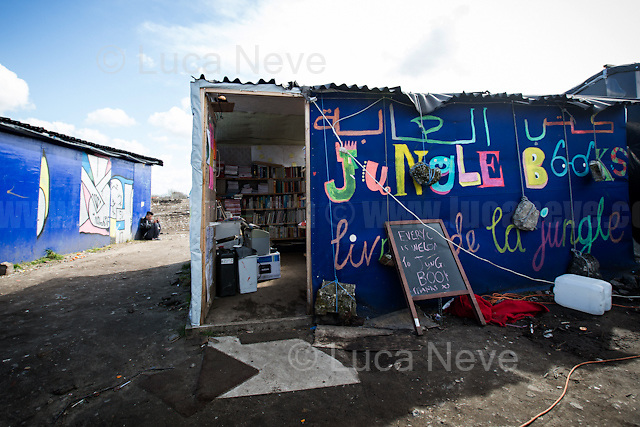 """Jungle Books.<br /> <br /> Calais Jungle Camp.<br /> <br /> Under the Sky of Calais & Dunkirk. Two Camps, Two Sides of the Same Coin: Not 'migrants', Not 'refugees', just Humans.<br /> <br /> France, 24-30/03/2016. Documenting (and following) Zekra and her experience in the two French camps at the gate of the United Kingdom: Calais' """"Jungle"""" and Dunkirk's """"Grande-Synthe"""". Zekra lives in London but she is originally from Basra in Iraq. Zekra and her family had to flee Kuwait - where they moved for working reason - due to the """"Gulf War"""", and to the Western Countries' will to """"export Democracy in Iraq"""". Zekra is a self-motivated volunteer and founder of """"Happy Ravers"""", a group of people (not a NGO or a charity) linked to each other because of their love for rave parties but also men and women who meet up every week to help homeless people and other people in need in Central London. (Here there are some of the stories I covered about Zekra and """"Happy Ravers"""": http://bit.ly/1XVj1Cg & http://bit.ly/24kcGQz & http://bit.ly/1TY0dPO). Zekra worked as an English teacher in the adult school at Dunkirk's """"Grande-Synthe"""" camp and as a cultural mediator and Arabic translator for two medic teams in Calais' """"Jungle"""". Please read her story at the beginning of this reportage."""
