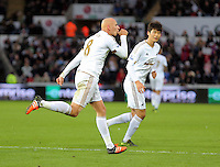 Jonjo Shelvey of Swansea (L) celebrates with Ki Sung Yueng (R) his goal scored from the penalty spot during the Barclays Premier League match between Swansea City and Bournemouth at the Liberty Stadium, Swansea on November 21 2015