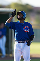 AZL Cubs 1 first baseman Rafael Mejia (58) points to the sky as he cross home plate after hitting a home run during an Arizona League game against the AZL Indians 1 at Sloan Park on August 27, 2018 in Mesa, Arizona. The AZL Cubs 1 defeated the AZL Indians 1 by a score of 3-2. (Zachary Lucy/Four Seam Images)