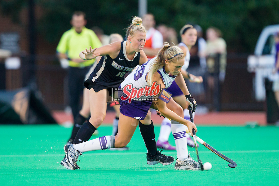 Lena Phillips (29) of the Northwestern Wildcats keeps the ball away from Madi Julius (10) of the Wake Forest Demon Deacons at Kentner Stadium on September 11, 2014 in Winston-Salem, North Carolina.  The Demon Deacons defeated the Wildcats 1-0.  (Brian Westerholt / Sports On Film)