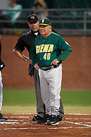 Umpire Ray Parrish looks over the shoulder of Siena Saints head coach Tony Rossi (40) while going over the ground rules before a game against the Stetson Hatters on February 23, 2016 at Melching Field at Conrad Park in DeLand, Florida.  Stetson defeated Siena 5-3.  (Mike Janes/Four Seam Images)