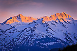Close up of Alpenglow on Chilkat Mountains, Inside Passage near Haines, SE Alaska in early summer.