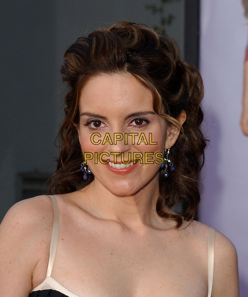 TINA FEY ..Attending the world premiere of Mean Girls at the Cinerama Dome, Hollywood, California...April 19th 2004..headshot portrait blue dangly earings..*UK sales only*..www.capitalpictures.com..sales@capitalpictures.com..©Capital Pictures