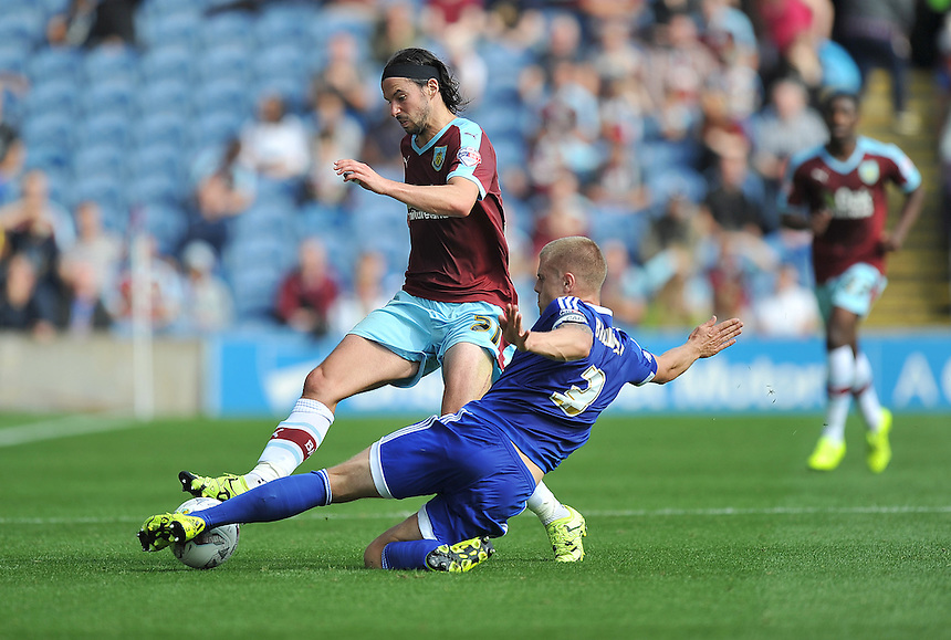 Burnley's George Boyd battles with Brentford's Jake Bidwell<br /> <br /> Photographer Dave Howarth/CameraSport<br /> <br /> Football - The Football League Sky Bet Championship - Burnley v Brentford - Saturday 22nd August 2015 - Turf Moor - Burnley<br /> <br /> &copy; CameraSport - 43 Linden Ave. Countesthorpe. Leicester. England. LE8 5PG - Tel: +44 (0) 116 277 4147 - admin@camerasport.com - www.camerasport.com