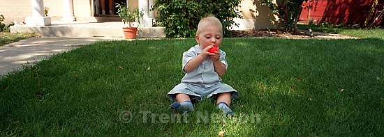 Noah Nelson chewing on a ball<br />