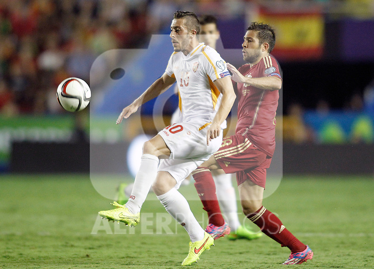 Spain's Jordi Alba (r) and Fyrom's Agim Ibraimi during 15th UEFA European Championship Qualifying Round match. September 8,2014.(ALTERPHOTOS/Acero)