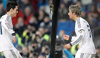 Real Madrid's Fabio Coentrao celebrates with Jose Callejon during La Liga match. December 16, 2012. (ALTERPHOTOS/Alvaro Hernandez)