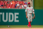 15 September 2013: Philadelphia Phillies shortstop Jimmy Rollins stands amused at a pigeon walking the infield during a game against the Washington Nationals at Nationals Park in Washington, DC. The Nationals took the rubber match of their 3-game series 11-2 to keep Washington's wildcard hopes alive. Mandatory Credit: Ed Wolfstein Photo *** RAW (NEF) Image File Available ***