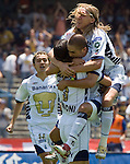 UNAM Pumas striker Fernando Morales is hugged by Bruno Marioni (2nd L), Leandro Augusto (R) as Jose Luis Lopez looks on after scoring the victory goal against Chiapas Jaguares during their soccer match at the University Stadium, April 02, 2006. UNAM Pumas won 2-1 to Chiapas Jaguares... Photo by © Javier Rodriguez