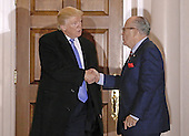 Former New York City Mayor Rudy Giuliani (R) shakes hands with United States President-elect Donald Trump at the clubhouse of Trump International Golf Club, in Bedminster Township, New Jersey, USA, 20 November 2016.<br /> Credit: Peter Foley / Pool via CNP