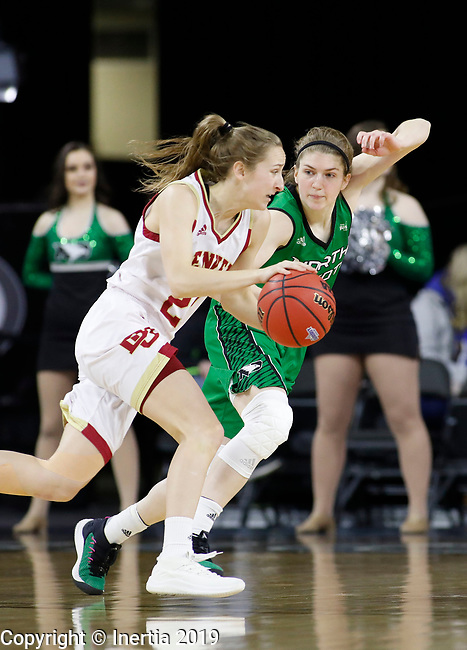 SIOUX FALLS, SD - MARCH 10: Samantha Romanowski #22 from Denver dribbles around Jill Morton #4 from North Dakota at the 2019 Summit League Basketball Tournament at the Denny Sanford Premier Center in Sioux Falls. (Photo by Dick Carlson/Inertia)