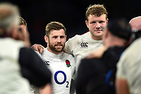 Elliot Daly and Joe Launchbury of England look on in a post-match huddle. Guinness Six Nations match between England and Italy on March 9, 2019 at Twickenham Stadium in London, England. Photo by: Patrick Khachfe / Onside Images