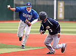 Wildcats' Taylor Smart runs down Golden Eagle Aaron Sandoval during Friday's college baseball game between Western Nevada College and College of Eastern Utah on April 15, 2011, in Carson City, Nev. .Photo by Cathleen Allison