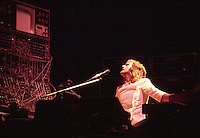 Keith Emerson performs on the keyboards and moog with the rock group Emerson Lake and Palmer.