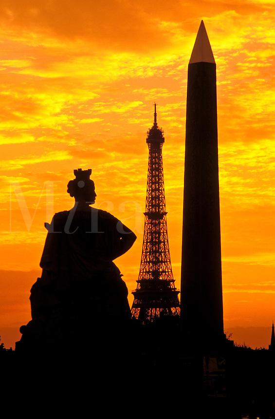 France, Paris. Place de la Concorde, Obelisk and Eiffel Tower in silhouette at sunset