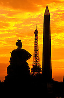 France, Paris. Place de la Concorde, Obelisk and Eiffel Tower in silhouette at sunset