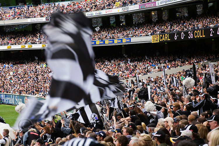 Supporters cheer on their teams during an AFL football game at the Melbourne Cricket Ground in Melbourne, Victoria, AUSTRALIA.