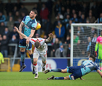 Max Muller of Wycombe Wanderers fouls James Collins of Crawley Town during the Sky Bet League 2 match between Wycombe Wanderers and Crawley Town at Adams Park, High Wycombe, England on 25 February 2017. Photo by Andy Rowland / PRiME Media Images.