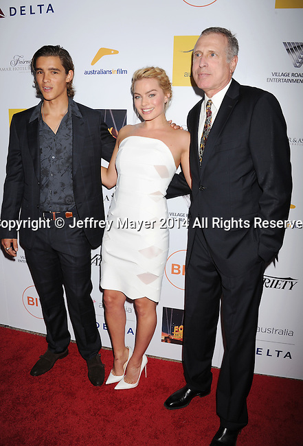 SANTA MONICA, CA- OCTOBER 26: (L-R) Actors Brenton Thwaites, Margot Robbie and Fred Baron attend the 3rd Annual Australians in Film Awards Benefit Gala at the Fairmont Miramar Hotel on October 26, 2014 in Santa Monica, California.