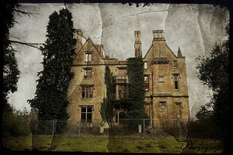 Textured photography of abandoned manor house surrounded by trees.
