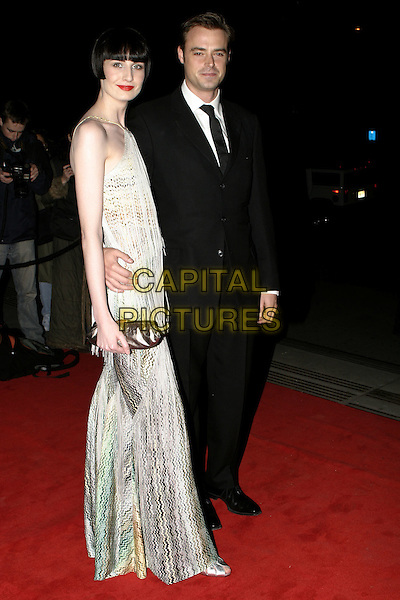 ERIN O'CONNOR & JAMIE THEAKSTON.The British Fashion Awards, Victoria and Albert (V&A) Museum, London, November 2nd 2004..full length couple clutch bag.Ref: AH.www.capitalpictures.com.sales@capitalpictures.com.©Capital Pictures.