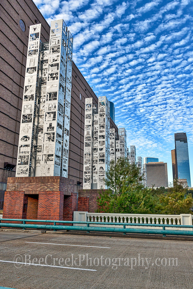 This is another view of the seven wonder art exhibit that run along side the Wortham win the Art District and the citys skyline. Each one of the colums is 70 ft tall and were created using children art. Watermark will not appear on image
