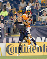New England Revolution defender A.J. Soares (5) and Houston Dynamo forward Cam Weaver (15) battle for head ball. In a Major League Soccer (MLS) match, the New England Revolution tied Houston Dynamo, 1-1, at Gillette Stadium on August 17, 2011.