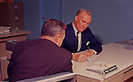 Pittsburgh PA:  A new customer is filling out an application to open a checking account at Mellon National Bank - 1964.  On location assignment for Fuller Smith and Ross for Mellon Bank.