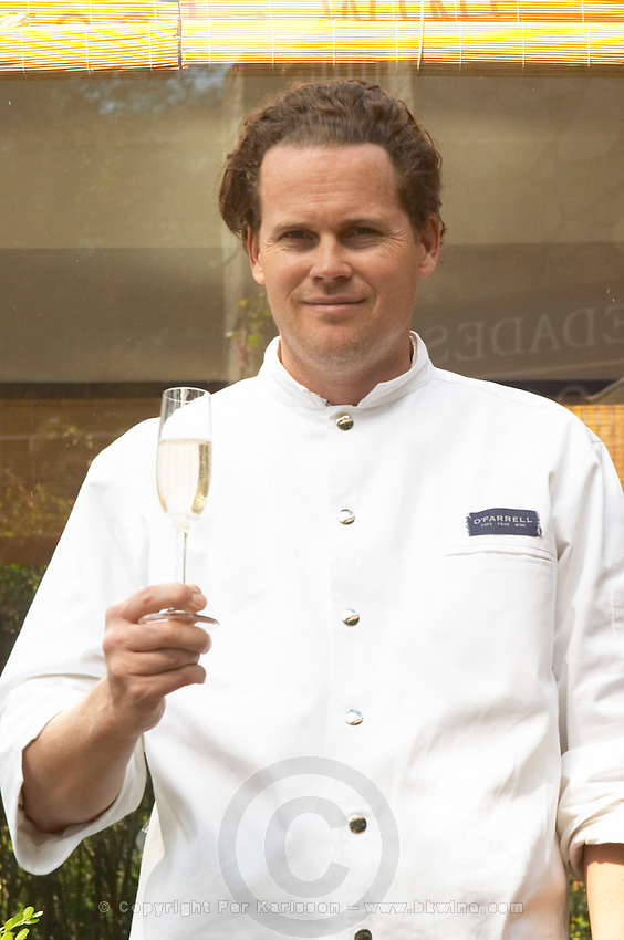 Hubert O'Farrell, chef cook and owner in front of the restaurant with a glass of sparkling wine The O'Farrell Restaurant, Acassuso, Buenos Aires Argentina, South America