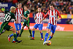Atletico de Madrid's Filipe Luis and Diego Godín and Real Betis's Dani Ceballos during La Liga match between Atletico de Madrid and Real Betis at Vicente Calderon Stadium in Madrid, Spain. January 14, 2017. (ALTERPHOTOS/BorjaB.Hojas)