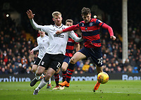 17th March 2018, Craven Cottage, London, England; EFL Championship football, Fulham versus Queens Park Rangers; Tim Ream of Fulham puts pressure on Pawel Wszolek of Queens Park Rangers