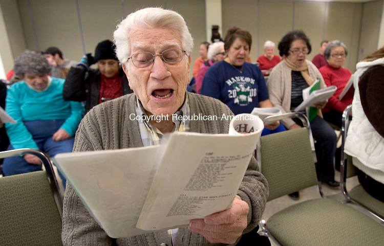 SOUTHBURY CT. 09 December 2014-010914SV01-Charlie Dickerson of Southbury sings loud while staying warm inside during a sing along at the Senior Center in Southbury Thursday.<br /> Steven Valenti Republican-American