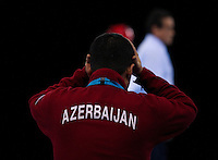 04 DEC 2011 - LONDON, GBR - The coach of Azerbaijan's Ramin Azizov (AZE) holds his head as he watches his competitor receive treatment during his men's -80kg category semi final contest with Sang-Bin Lee (KOR) at the  London International Taekwondo Invitational and 2012 Olympic Games test event at the ExCel Exhibition Centre in London, Great Britain .(PHOTO (C) NIGEL FARROW)