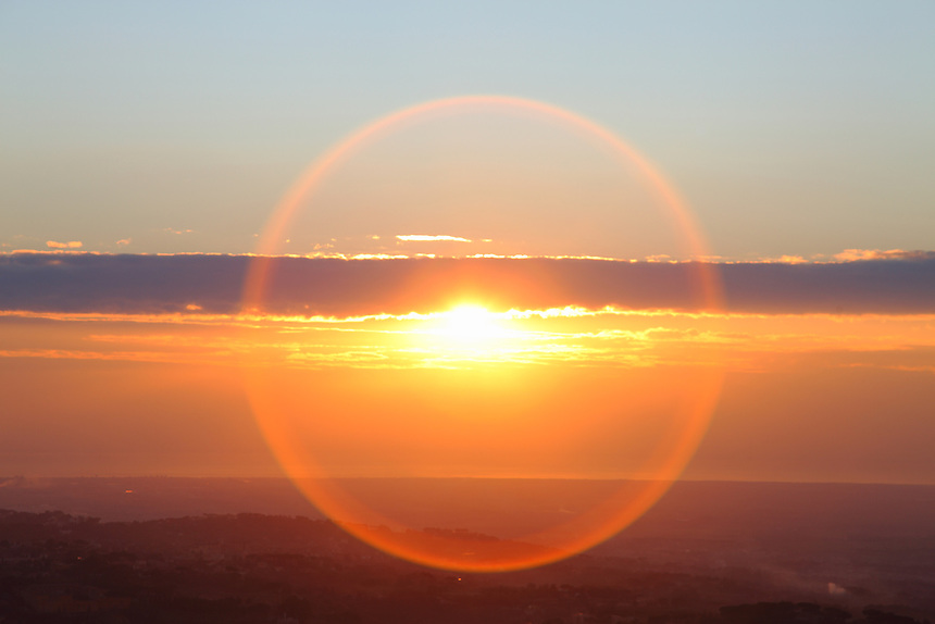 Here the sun coming out from some clouds in the late evening, with a nice optical effect that makes it surrounded by a circle of light. The photo has been taken in Tuscolo (near Monte Compatri).