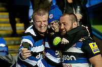 Tom Dunn of Bath Rugby poses for a selfie with supporters after the match. Aviva Premiership match, between London Irish and Bath Rugby on November 7, 2015 at the Madejski Stadium in Reading, England. Photo by: Patrick Khachfe / Onside Images