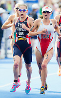 12 JUL 2014 - HAMBURG, GER - Kirsten Sweetland (CAN) (right) from Canada leads the front pack during the run at the elite women's 2014 ITU World Triathlon Series round in the Altstadt Quarter in Hamburg, Germany (PHOTO COPYRIGHT © 2014 NIGEL FARROW, ALL RIGHTS RESERVED)
