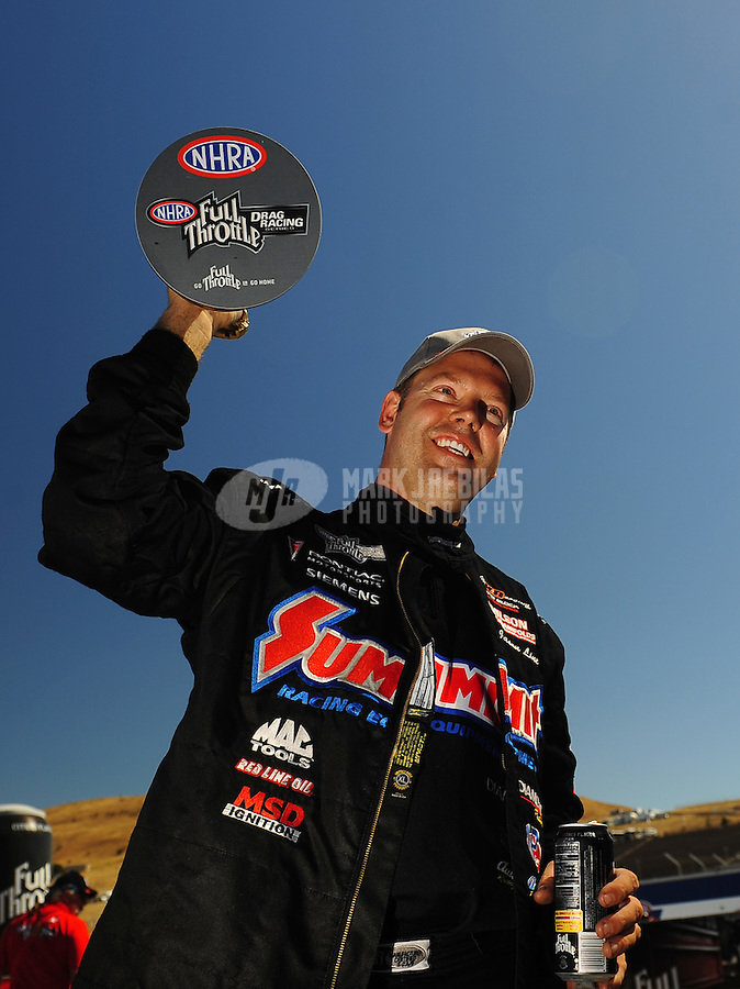 Jul. 26, 2009; Sonoma, CA, USA; NHRA pro stock driver Jason Line celebrates after winning the Fram Autolite Nationals at Infineon Raceway. Mandatory Credit: Mark J. Rebilas-