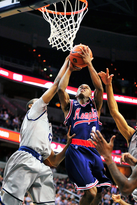 Joe Jackson of Memphis has his shot blocked underneath the basket. Georgetown defeated Memphis 70-59 at the Verizon Center in Washington, D.C. on Thursday, December 22, 2011. Alan P. Santos/DC Sports Box