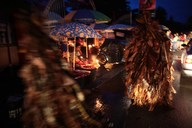 "Devout Catholics in the village of Bibiclat, on Luzon island, Philippines, honor their patron saint, John the Baptist, with the annual Taong Putik, or ""mud people"" festival. Devotees rise before dawn, smear their bodies with mud and dress themselves in cloaks made from banana leaves and vines, which symbolize the animal skins the saint wore in the Bible. June 24, 2011."