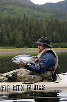 Kayak fishing for Silver salmon (Coho) in the Valdez, Alaska area of south central Alaska with Pacific Mountain Guides outfitter Otto Kulm. Fishing was done in both salt water and fresh water in the Prince William Sound region. Otto Kulm holds a nice salt water fly caught Coho. Otto Kulm holds a nice salt water fly caught Coho.
