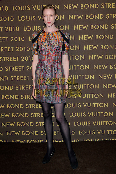 JADE PARFITT .attends the launch of the Louis Vuitton Bond Street Maison in London, England, UK, May 25th, 2010..full length orange grey gray paisley print dress tights black patterned pattern .CAP/PL.©Phil Loftus/Capital Pictures.