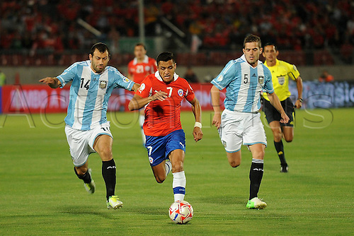 17.10.2012 Santiago City, Chile. World Cup 2014 Qualification Chile v Argentina. Alexis Sanchez C of Chile against Fernando Gago r and Javier Mascherano l of Argentina.