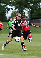BOYDS, MARYLAND - July 21, 2012:  Hayley Siegel (12) of DC United Women is tackled by Megan Weston (16) of the Virginia Beach Piranhas during a W League Eastern Conference Championship semi final match at Maryland Soccerplex, in Boyds, Maryland on July 21. DC United Women won 3-0.