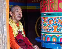 A monk spins a prayer wheel in the Dudh Kosi River Valley on the