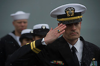 130504-N-DR144-089 ANCHORAGE, Alaska (May 4, 2013)- Lt. Gary Ross salutes while rendering honors during the commissioning of San Antonio-class amphibious transport dock ship USS Anchorage (LPD 23) at the Port of Anchorage. More than 4,000 people gathered to witness the ship's commissioning in its namesake city of Anchorage, Alaska. Anchorage, the seventh San Antonio-class LPD, is the second ship to be named for the city and the first U.S. Navy ship to be commissioned in Alaska. (U.S. Navy photo by Mass Communication Specialist 1st Class James R. Evans / RELEASED)