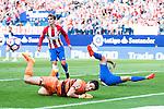 Atletico de Madrid's player Antoine Griezmann and Ángel Martín Correa and Deportivo de la Coruña's player Poroto Lux during a match of La Liga Santander at Vicente Calderon Stadium in Madrid. September 25, Spain. 2016. (ALTERPHOTOS/BorjaB.Hojas)